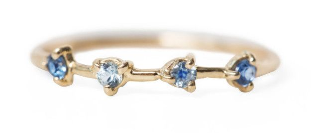 A four-stone sapphire ring for anyone with the blues. | 29 Dainty Pieces Of Jewelry That Are Worth The Investment