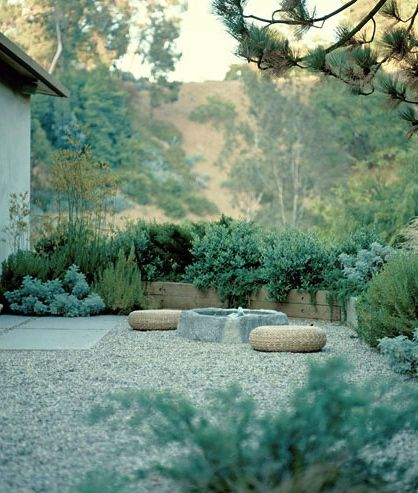 Calming blue-green palette and pleasing use of stone in design by Elysian Landscapes.