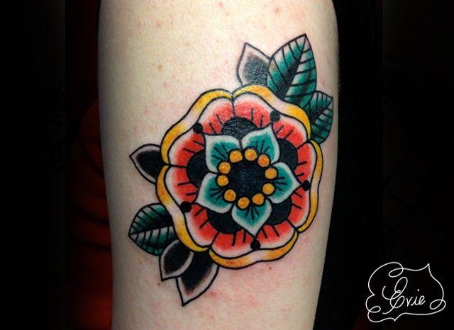 Traditional Geometric Flower tattoo by Evie Yapelli, showpigeon.com