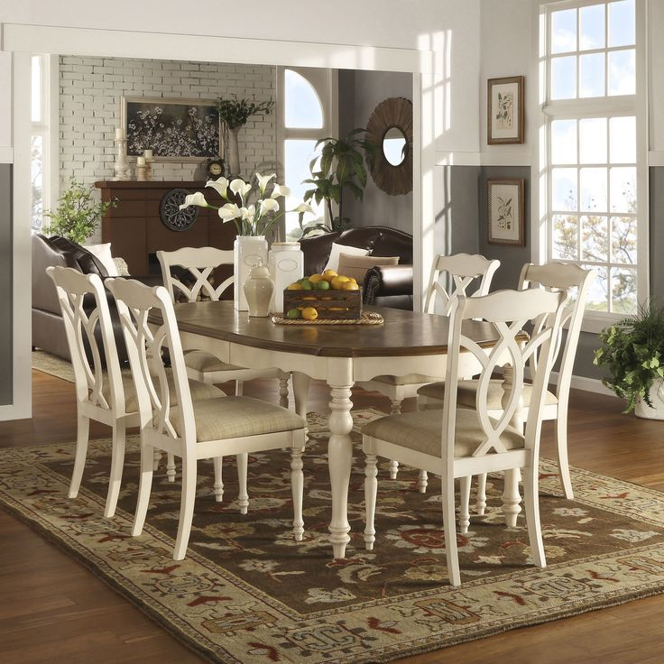 Comfortable yet classic this collection features a spacious table top with a natural finish, and each seat of the coordinating chairs is covered in beige fabric and adorned with elaborate carvings giving your dream dining room a hint of southern charm.