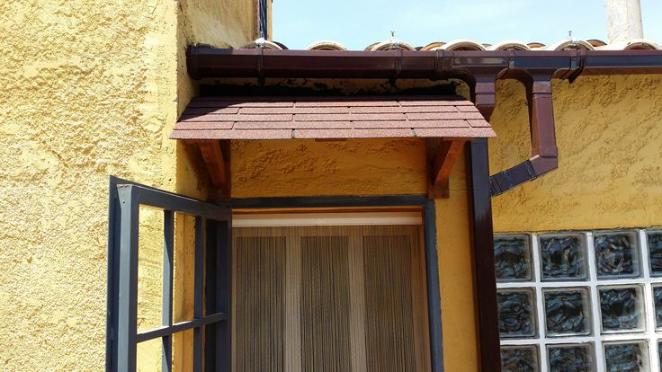 #DiyPalletCanopy, #DiyPalletPorchRoof, #DiyPalletPortico, #PalletCanopy, #PalletPortico, #Porch, #PorchRoof, #RepurposedPallets, #Reuse, #Roof, #Rustic We originally had an aesthetically horrible piece of corrugated iron as the Pallet Portico/Canopy. We decided to use pallet wood to make some changes!After I had removed the original portico, I installed a rain gutter in because of clearance