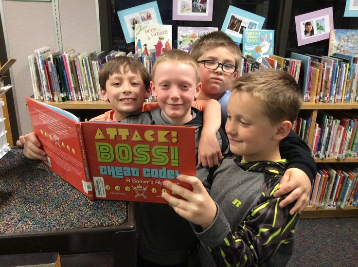 Some friends enjoying Attack! Boss! Cheat Code! : A Gamer's Alphabet by @Bartography They love the caveman pic.