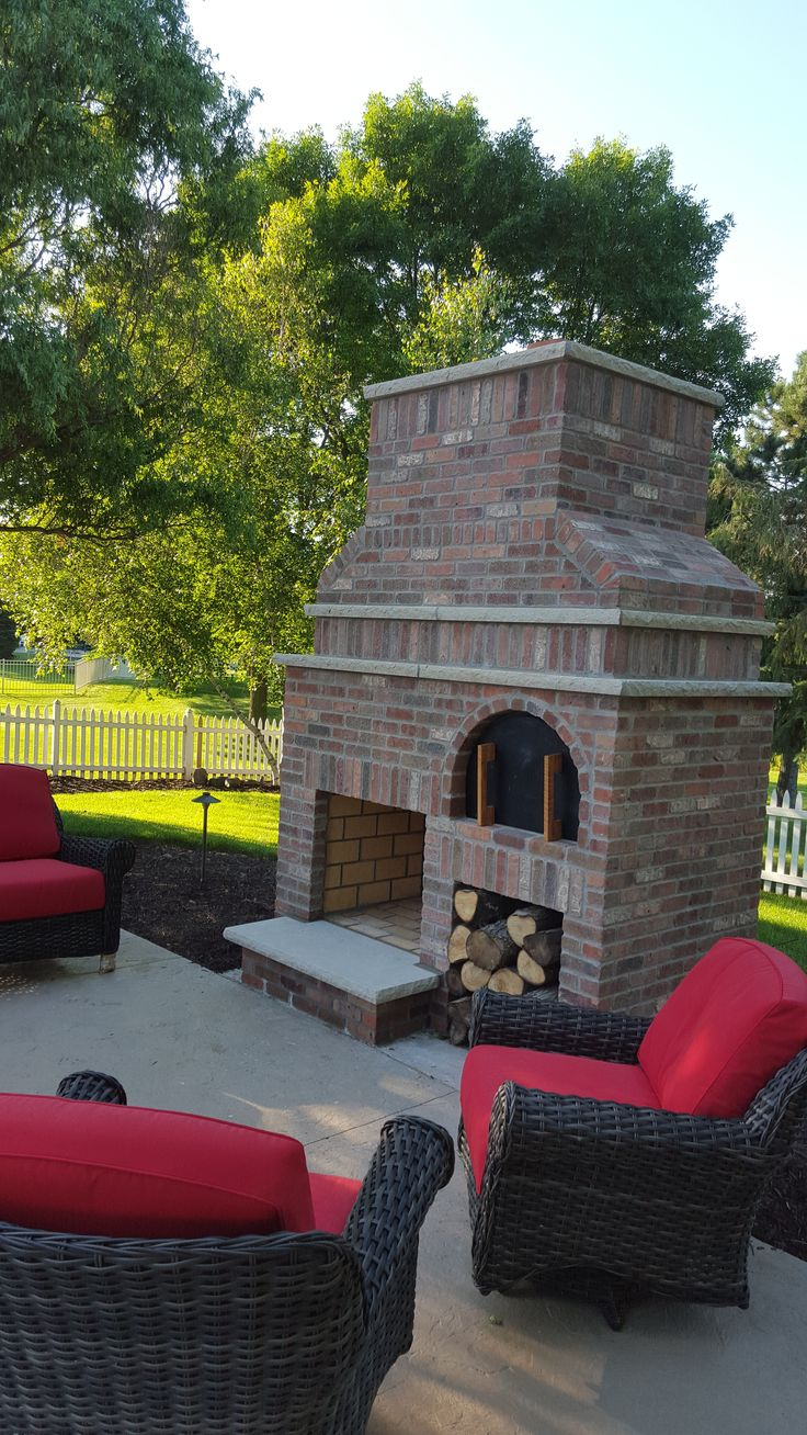 Brick Outdoor Fireplace with wood fired pizza oven and Indiana limestone trim. Robinson brick--Cambridge used for fireplace
