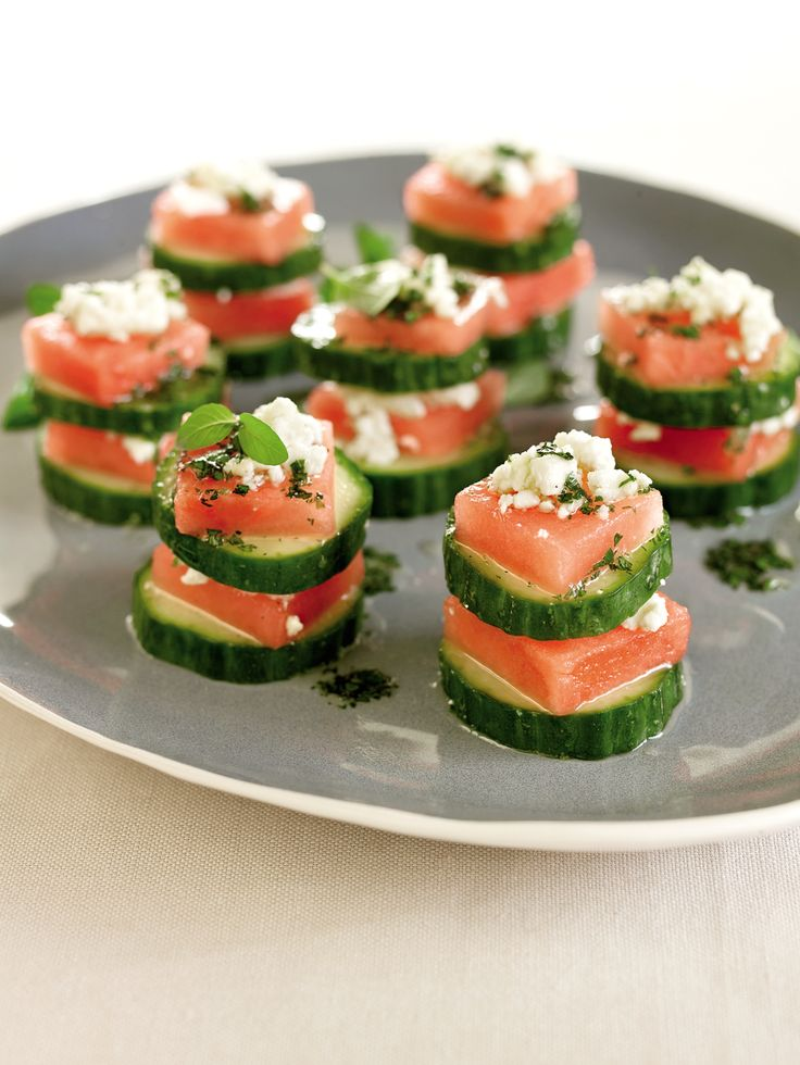 Sweet, salty and creamy--these stacks cover all the bases. Assemble and refrigerate the stacks up to 3 hours in advance. Then drizzle with the honey lime sauce just before serving. Scatter the platter with fresh mint leaves for a festive occasion. This recipe makes a good pre/postworkout snack.