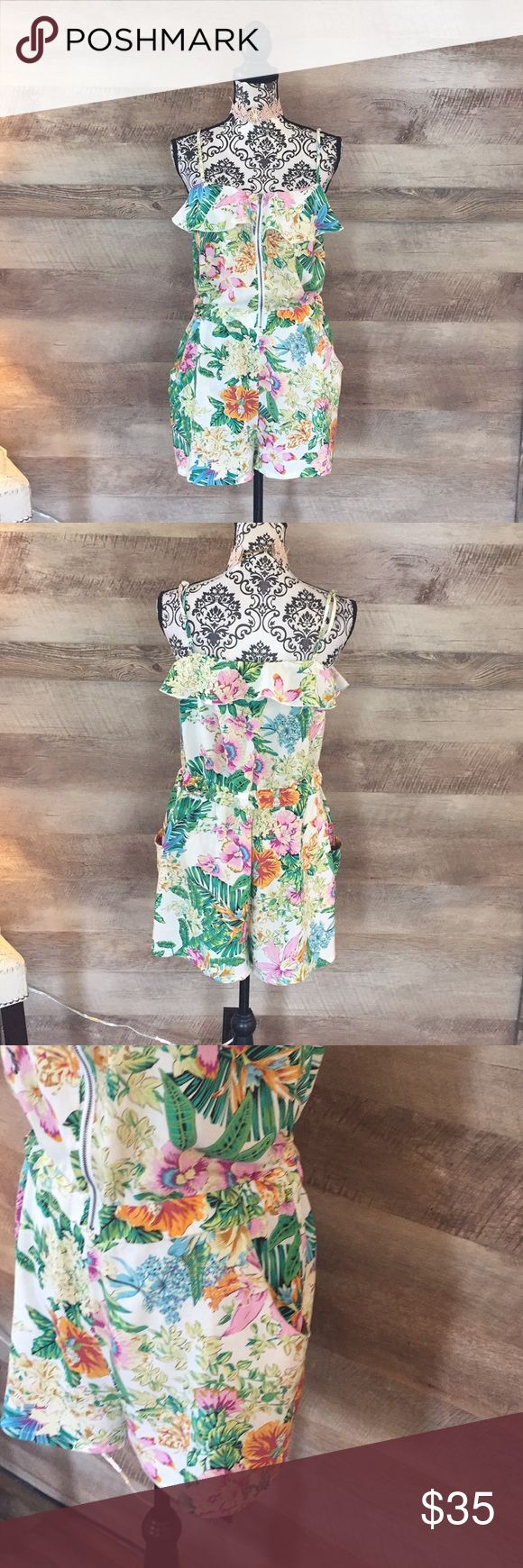 Palm Leaf Floral Zip Up Romper Zip up front. Ruffled bodice. Wide Leg. Palm leaf and floral print. Size XL. Pastel colors. 100% rayon Pants Jumpsuits & Rompers