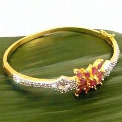 Ruby Flower CZ American Diamond Gold Plated Bracelet Bangle Beautifully hand crafted bracelet bangle Sparkles like real diamond gold bracelet bangle High quality American Diamonds are used Sleek fit bracelet Free size - fits every hand Gold plated bracelet bangle   ₹799.00 INR buy at http://crazyberry.in/online-shopping/artificial-imitation-fashion-jewellery/ruby-flower-cz-american-diamond-gold-plated-bracelet-bangle