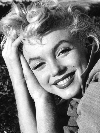 """I don""""t mind living in a man's world as long as I can be a woman in it. - Marilyn Monroe"""