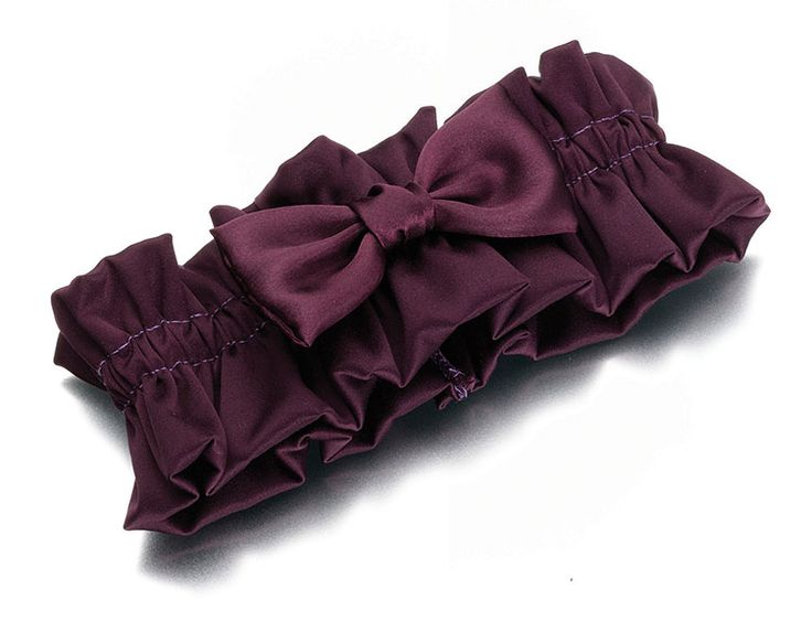 This beautiful garter is made of plum purple colored satin with a  coordinating satin bow. One size fits most.