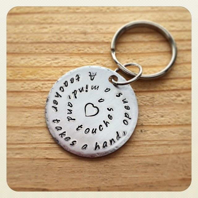 "Teacher's gift. Hammered aluminium keychain, hand stamped with quote - ""A teacher takes a hand, opens a mind, and touches a heart"" ..."