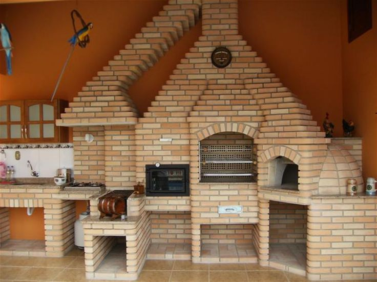 Cellar conversion: indoor Brazilian barbecue complete with wood-burning ovens and sink.