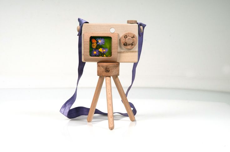 wooden tripod and camera