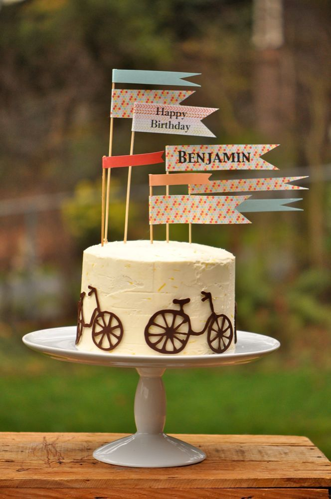 Birthday bicycle cake with paper banners. Trader Joes Chocolate Torte with lemon buttercream and piped chocolate bicycles. Chris and Sonja - The Sweet Seattle Life