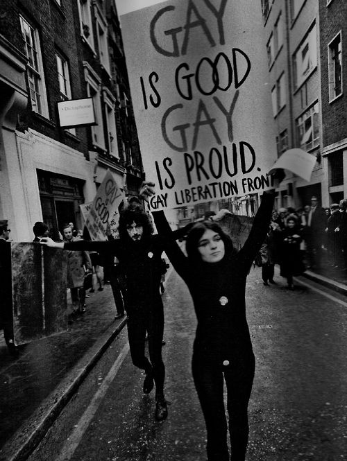 A gay pride event in London featuring actors and mime artists marches through Soho, 1972