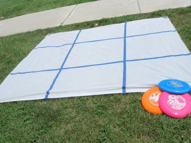 Get a shower curtain from Dollar Tree and use cheap tape (also from Dollar Tree) to make a Tic Tac Toe grid. Then set 6 frisbees out. Stand behind a line and see who had the best aim! Not as easy as you would think!