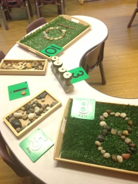 Exploring number @ New Horizons Preschool. Love the fake grass in the tray.