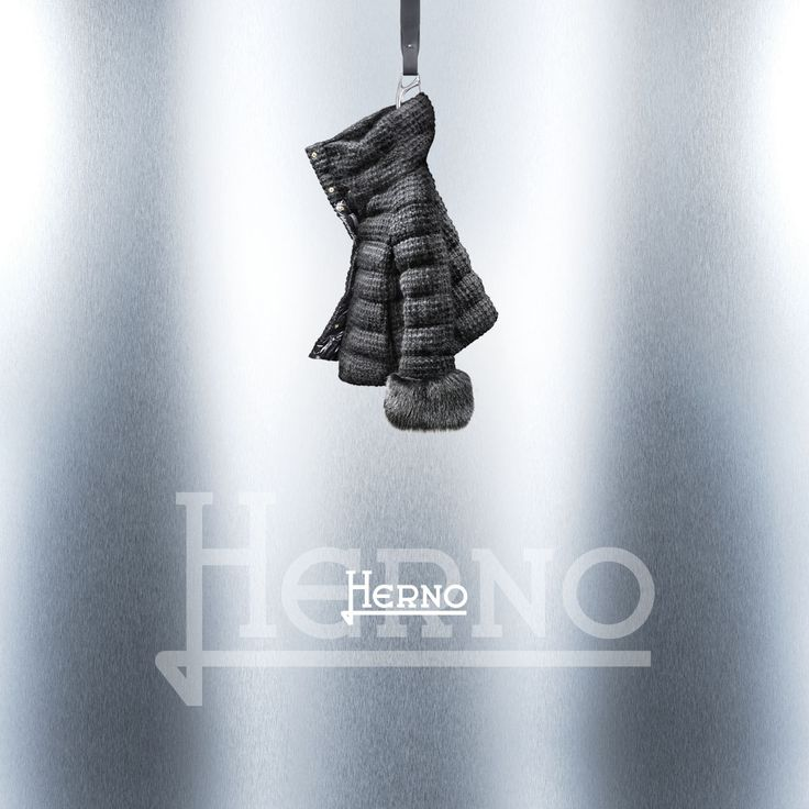 An exercise of style on ultralight downs for the sport couture collection Herno Signature Interlacing woolen yarns for a tone on tone micro check Goose down padded   Hidden snaps fastening Crater shape collar and detachable fox fur cuffs