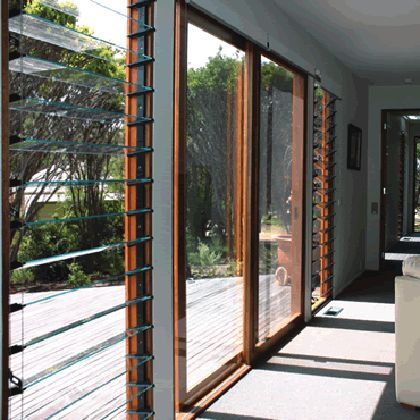 Entrance. Sliding door with louvres either side