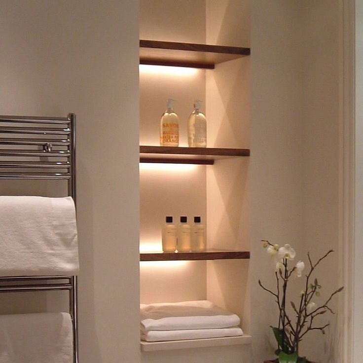 Open a wall between studs to store towels and decorative items