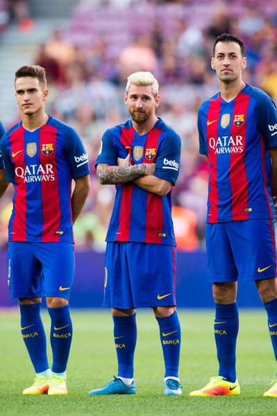 (L-R) Denis Suarez, Lionel Messi and Sergio Busquets of FC Barcelona look on during the team official presentation ahead of the Joan Gamper trophy match between FC Barcelona and UC Sampdoria at Camp Nou on August 10, 2016 in Barcelona, Catalonia.