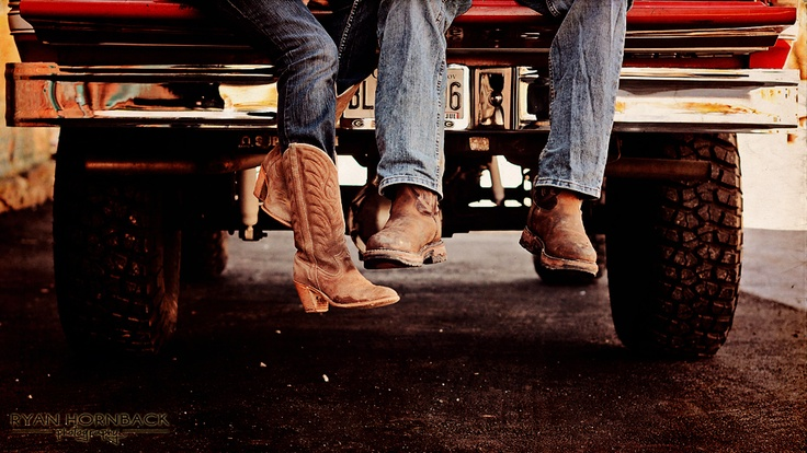 country couple in cowboy boots and a red chevrolet truck