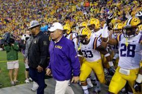 LSU head coach Les Miles walks his team onto the field before an NCAA college football game against Auburn in Baton Rouge, La., Saturday, Se...