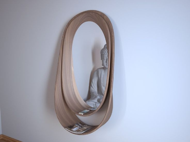 "DOUBLE LOOP by Libero Rutilo of DesignLibero is a Mirror holder consisting of two ""bands"" in solid wood with stylish curves."