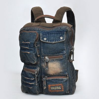 This sick denim rucksack., an ideal school bag. Compact backpack crafted from durable denim. Topped with distressed and fading detailing. Lined interior with a open pockets and a zip pocket. Exterior 4 pull-zip front pocket and 1 snap front pocket keeps essentials handy. Padded, adjustable shoul...