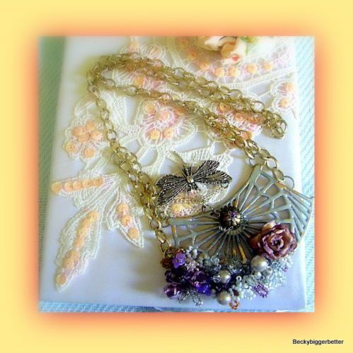 Sweet Victorian Romantic Altered Floral Pendant. Necklace has Dragonfly rose red Hearts, and  Crystals with gold chain