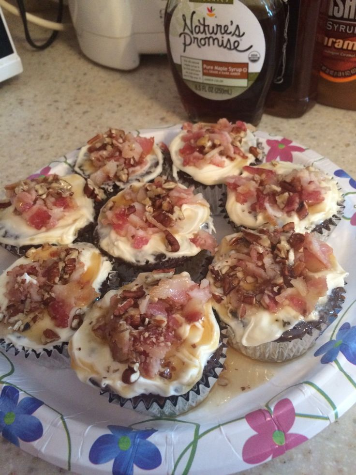 Maple, Bacon, Jack Daniels Chocolate cupcakes w/ caramel drizzle,cream cheese icing & pecans.   I started with Devils Food box mix, added an extra egg, used milk instead of water & butter instead of oil (doubling the amount of butter to the recommended amount of oil). I added chopped bacon that I had cooked fresh in the oven at 375 for 25 minutes. I added 2 shots of Jack & 2 spoonfuls of baking powder. I baked per the boxes instructions. Let cool. Drizzled caramel over each one. Let that…
