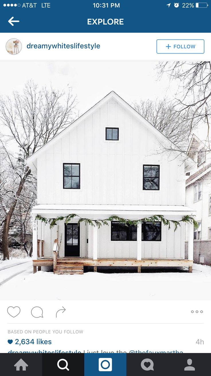 Minimalist farmhouse exterior white with black windows
