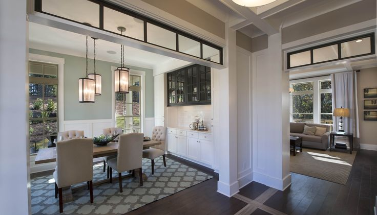 The Madison Designer Model at Woodmont Golf and Country Club | Open Dining Room with Transom Windows and Built-in Buffet