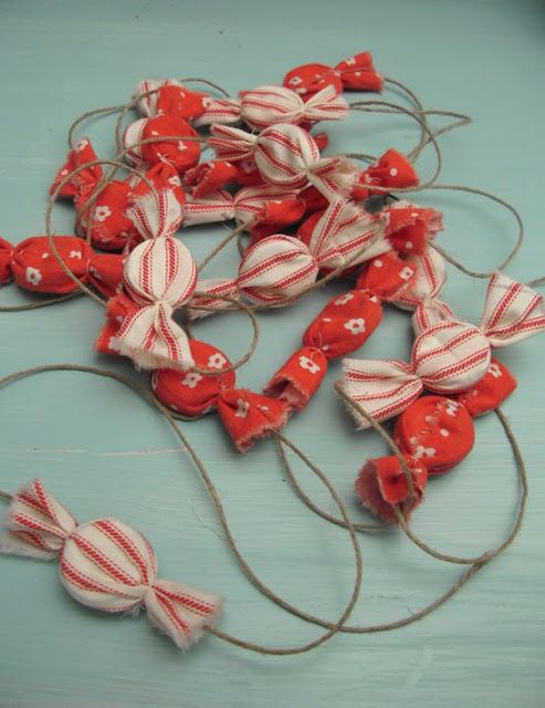 Scrap fabric candy bunting. Use plastic bottle caps instead of foam for centers. via Parolan Asema