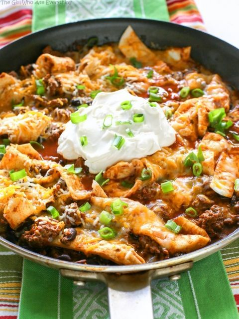 This Easy Beef Burrito Skillet has beef, black beans, salsa, and tortillas all cooked in one skillet. The tortillas turn soft and almost like a dumpling. This tasty dish is done in less than 20 minutes. the-girl-who-ate-...