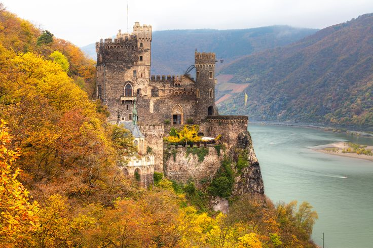 One of the ultimate autumn travel moments: Spotting Rheinstein Castle surrounded by fall colors high above the Rhine River.