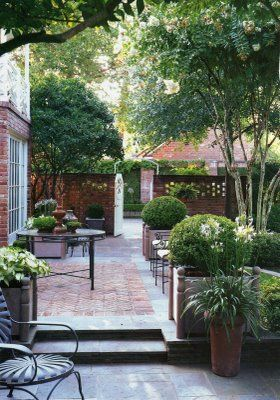 wonderful use of boxwood in pots on this patio..classic!