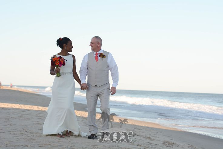 Wedding couple elopes on Bethany beach DE during a sunny afternoon in October:  https://www.roxbeachweddings.com/