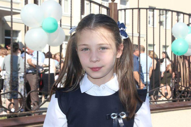 Abkhaz Abaza girl, school, student, two ponytails, double side, ribbon, balloons, wrought iron fence, Abkhazia (Eastern Europe), Circassian, Abkhazian, Caucasian people