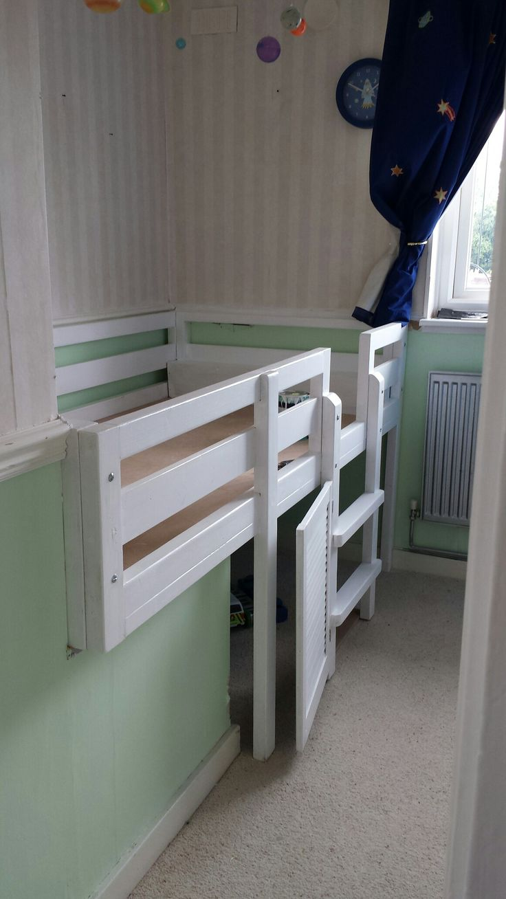 Our custom designed bed to incorporate stair bulkhead / box