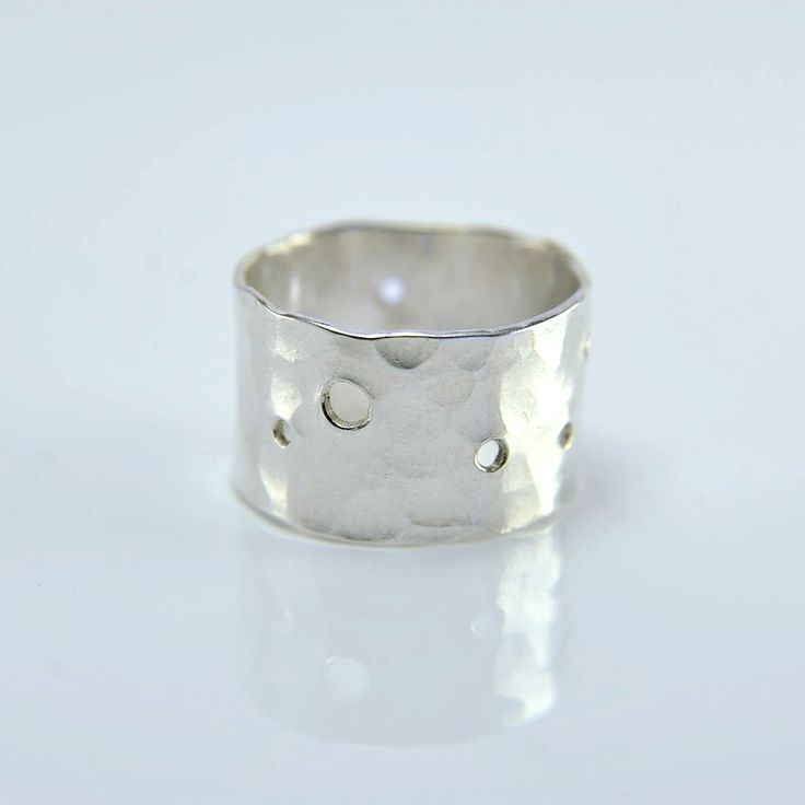 Handmade wide silver band with organic hammered pattern and drilled holes made by MonaPink