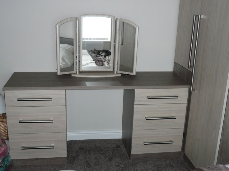 Dark swiss elm worktop and carcasses and light swiss elm drawer fronts on dressing table with matching mirror! (and the Cat in the mirror)