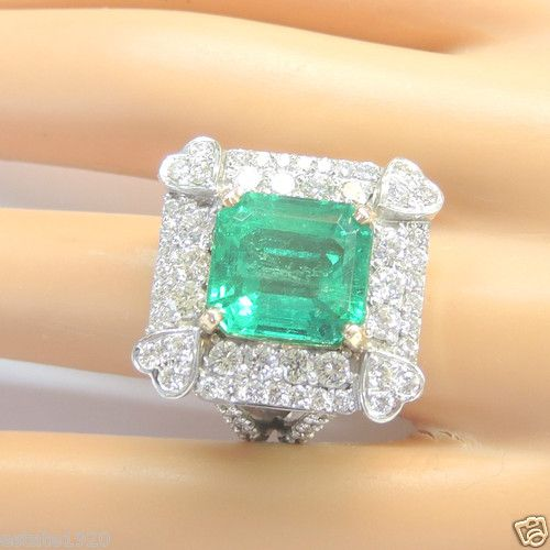 FINE COLOMBIAN EMERALD DIAMOND ENGAGEMENT RING  CIRCA ~ 1990'S   COLOMBIAN EMERALD   SHAPE ~ EMERALD CUT   SIZE ~ 10.12 CARAT   MEASUREMENT OF EMERALD ~ 13.29 MM (0.5235 INCHES) x 12.28 MM (0.484 INCHES)   AGTA APPROVED ~ CEDAR OIL TREATMENT   60 ROUND BRILLIANT CUT DIAMONDS ~ 3.40 CARAT TOTAL WEIGHT  COLOR ~ G - H  CLARITY ~ VS 1 - VS 2  METAL ~ 18K WHITE SOLID GOLD  WEIGHT ~ 23 GRAMS  FINGER SIZE ~ 8.25 (SIZABLE) (Inquire About Sizing Cost)  (Q) UNITED KINGDOM, IRELAND, AUSTRALIA & NEW…