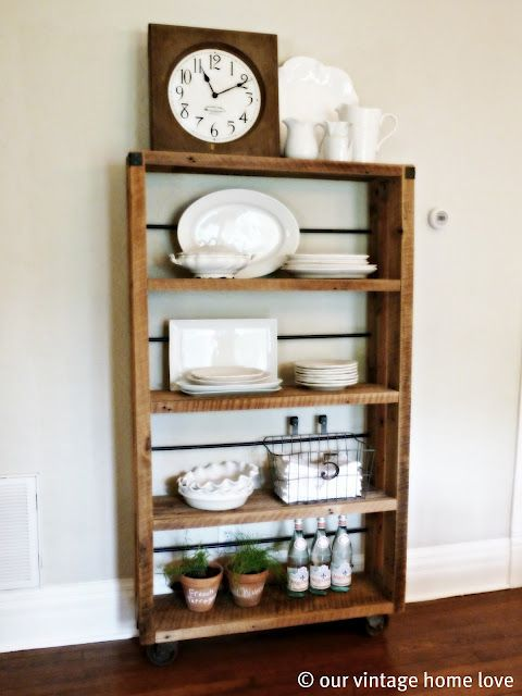 DIY reclaimed wood shelving - metal rods are dowels painted with oil rubbed bronze spray paint