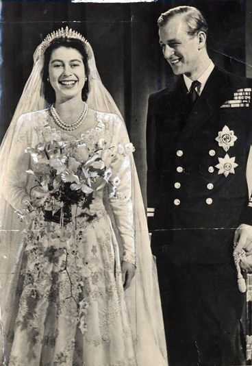 Queen Elizabeth picked a two strand classic pearl necklace for her wedding - fantastic choice. Double-strands forever! :o)