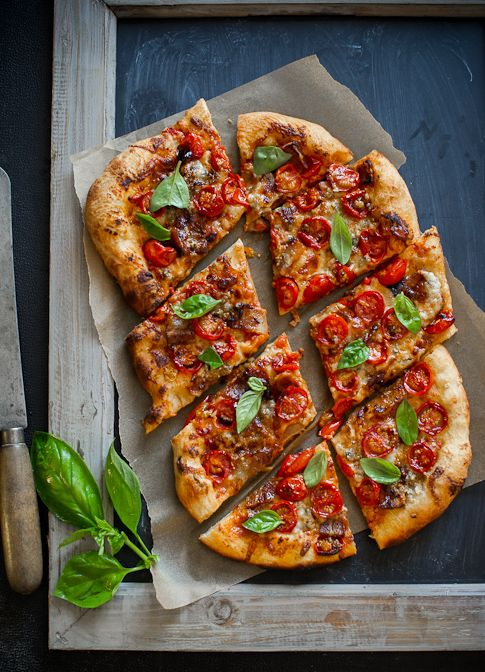 A pizza with cherry tomatoes, bacon and blue cheese sounds pretty delicious.