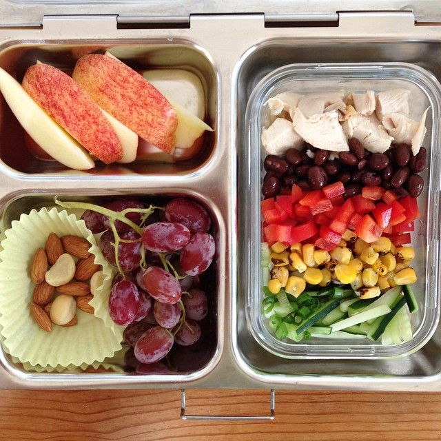 Today's lunch: * Rotisserie chicken, black beans, red bell pepper, blackened corn, cucumber, green onions over rice * Red grapes * Almonds & macadamia nuts * Gala apple | @kbqsurfs