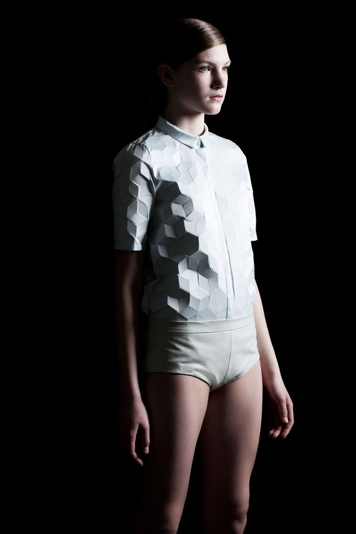 Reworking the basic short sleeved shirt with the visual impact of heightened textile that, from a 2D perspective, is challenged via shadow and form. Credit: Alba Prat