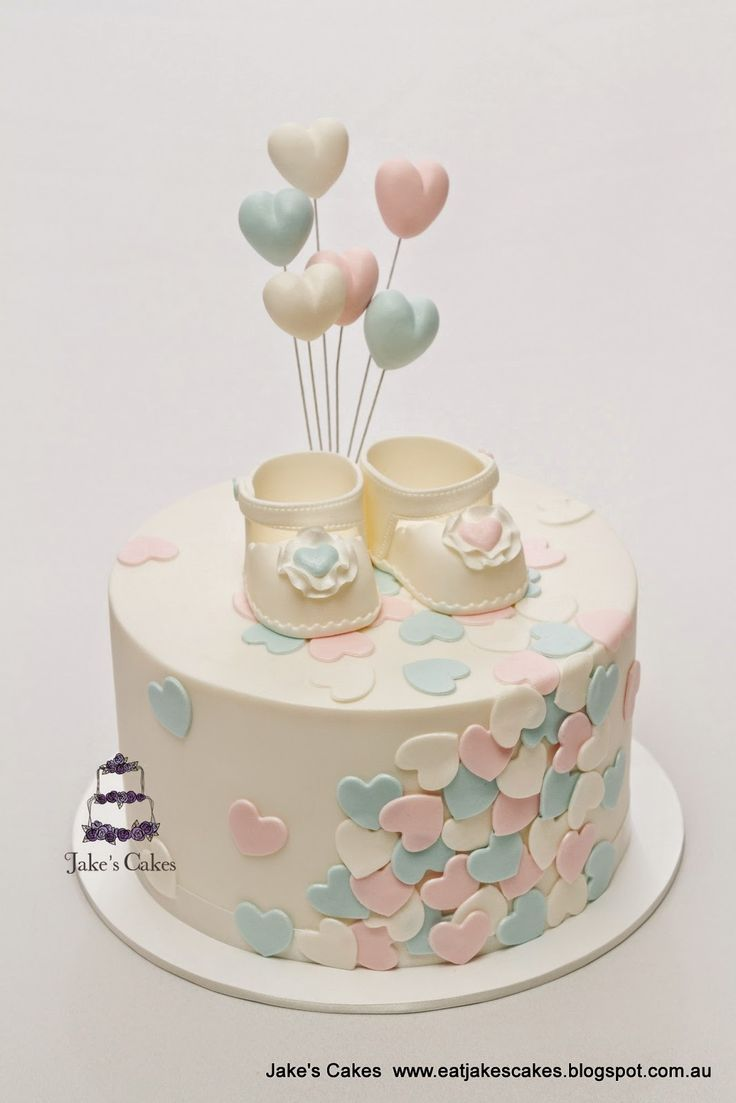 Baby shower cake for boys or girls - adorable gender neutral cake with baby shoes and lots of hearts!
