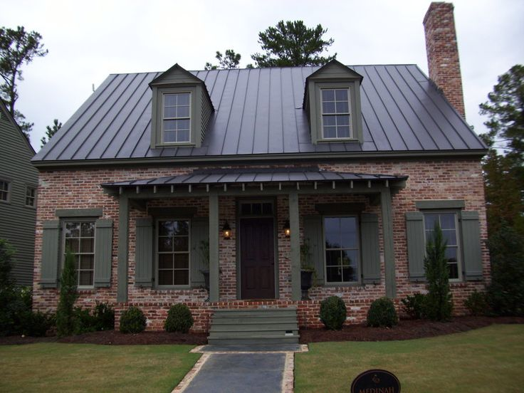 Dark brown metal roof morgan st home exterior for Red brick house with metal roof