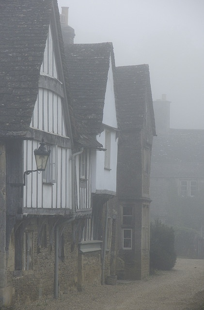 Lacock, Wiltshire. Revel in Tudor, half-timbered black and white buildings. Lacock, on the southern edge of the Cotswolds, was once a centre of the medieval wool trade. Today it still reflects those times, and no TV aerials, overhead cables or yellow lines on its streets spoil the scene.