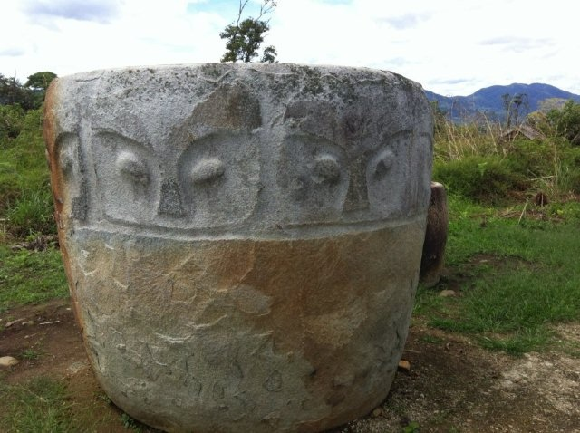 Pokekea Archeological Site. Megaliths of Bada Valley - Central Sulawesi, Indonesia. In this pristine valley there are scattered hundreds of impressive ancient stone statues and kalamba - enormous stone cisterns.
